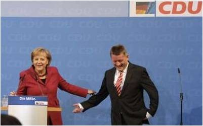 German Chancellor Angela Merkel and Hermann Groehe of the conservative Christian Democratic Union
